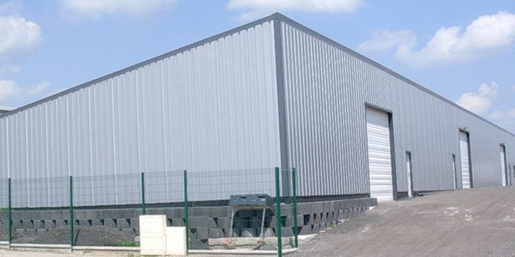 How do I ground a metal building or metal warehouse with metal frame sidings for proper inspection?