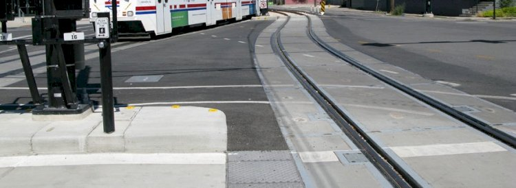 What is the safe maximum voltage at a railroad-highway grade crossing during?